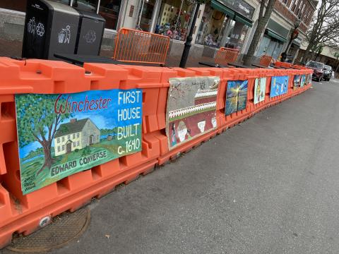 Art on barriers at First House Pub